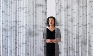 Palestinian-British artist Mona Hatoum stands behind her artwork 'Impenetrable'