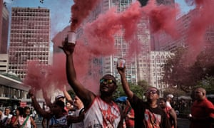 Protesters release red smoke, the colour of the Brazilian Workers' party, at a demonstration in Rio de Janeiro last week.