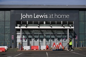 Signs on a John Lewis store inform customers of its temporary closure in Tunbridge Wells