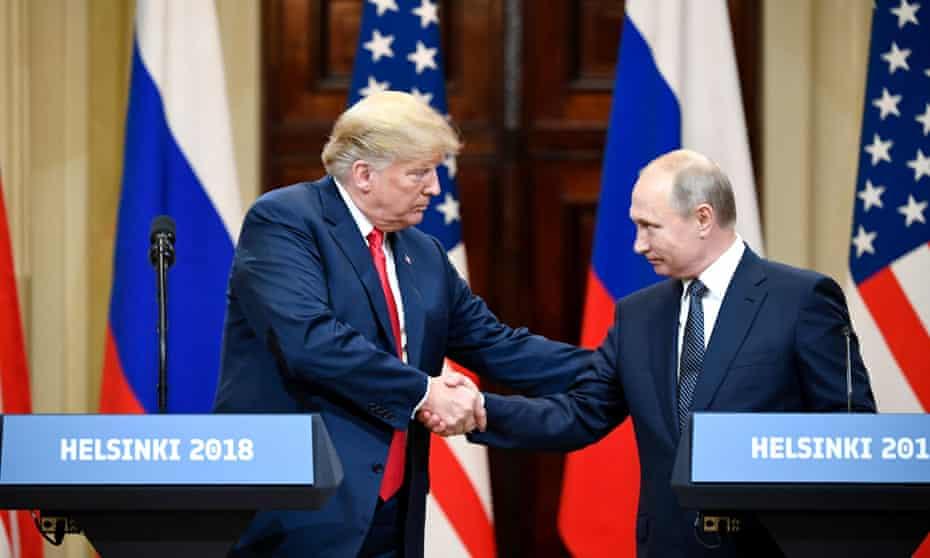 Donald Trump and Vladimir Putin shake hands in Helsinki