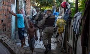 Members of Feira de Santana's elite Rondesp police unit search a house in the Favela do Arreia.