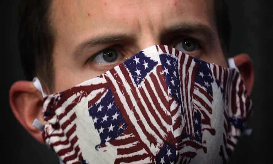 A United States Senate staffer wears a mask with American flags on it