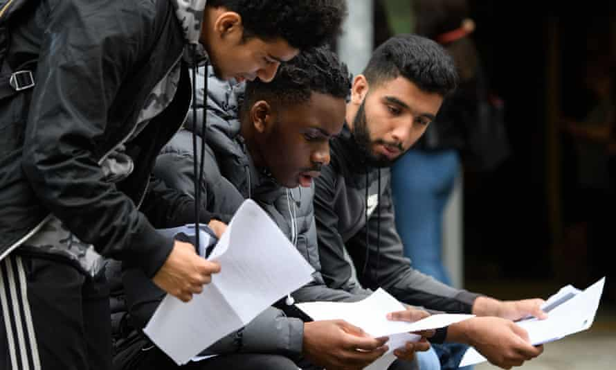 Male students receive their A-level results at a London college