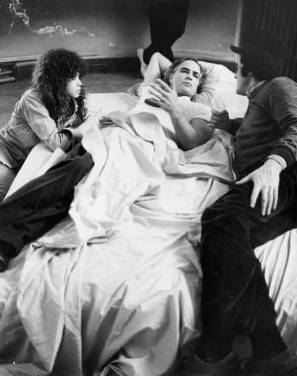 Marie Schneider and Marlon Brando with director Bernardo Bertolucci, on the set of Last Tango In Paris