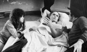 Marie Schneider said in 2007 that she 'felt a little raped, both by Marlon [Brando, centre] and Bernardo [Bertolucci, right]' while filming the notorious scene.