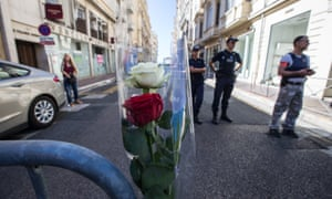 Security personnel stand guard near the Promenade des Anglais.