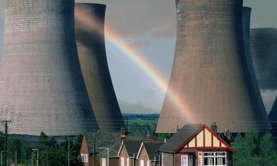 Houses in Rugeley with power-station cooling towers in the background and a rainbow