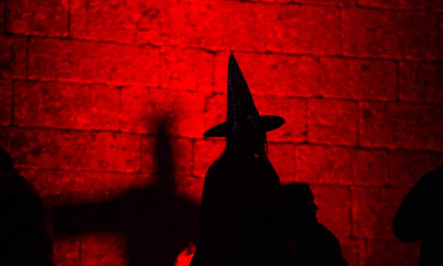 Silhouette of a person dressed as a witch