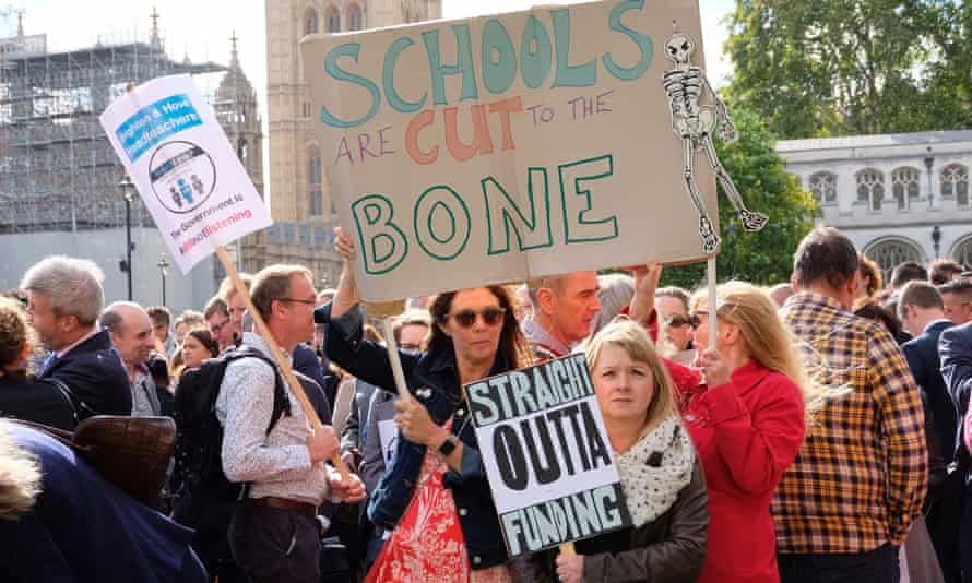 Headteachers march through Westminster to protest against funding cuts.