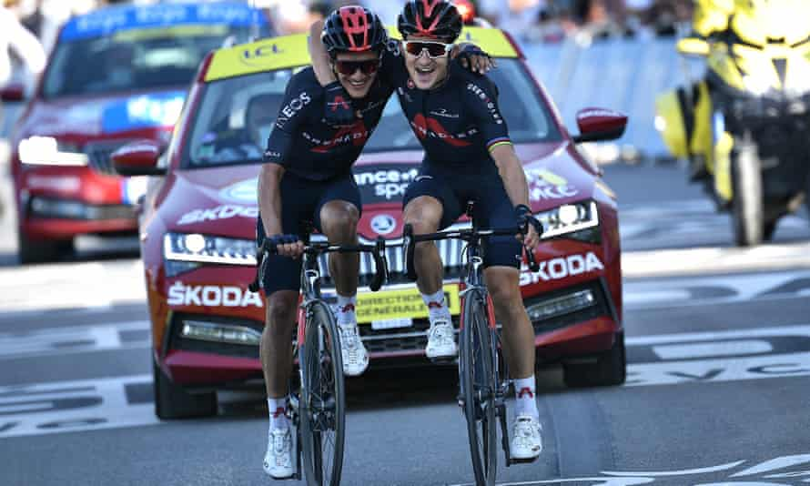 Michal Kwiatowski (right) and his Ineos Grenadiers teammate Richard Carapaz celebrate after coming home first and second in La Roche-sur-Foron