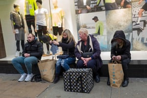 Shoppers wait for a bus outside Primark in Marble Arch