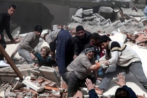 Residents of the city of Van in eastern Turkey rescue two women trapped in rubble by a powerful earthquake. Officials fear the death toll could reach 1,000.