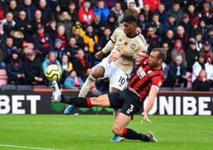 Bournemouth's Steve Cook thwarts Manchester United's Marcus Rashford.