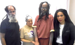 Mumia Abu-Jamal, third from the left, in a picture taken last April after his medical emergency with his brother Keith Cooke, and supporters Pam Africa and Johanna Fernández.