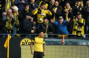Dortmund fans and Jadon Sancho after his first goal.