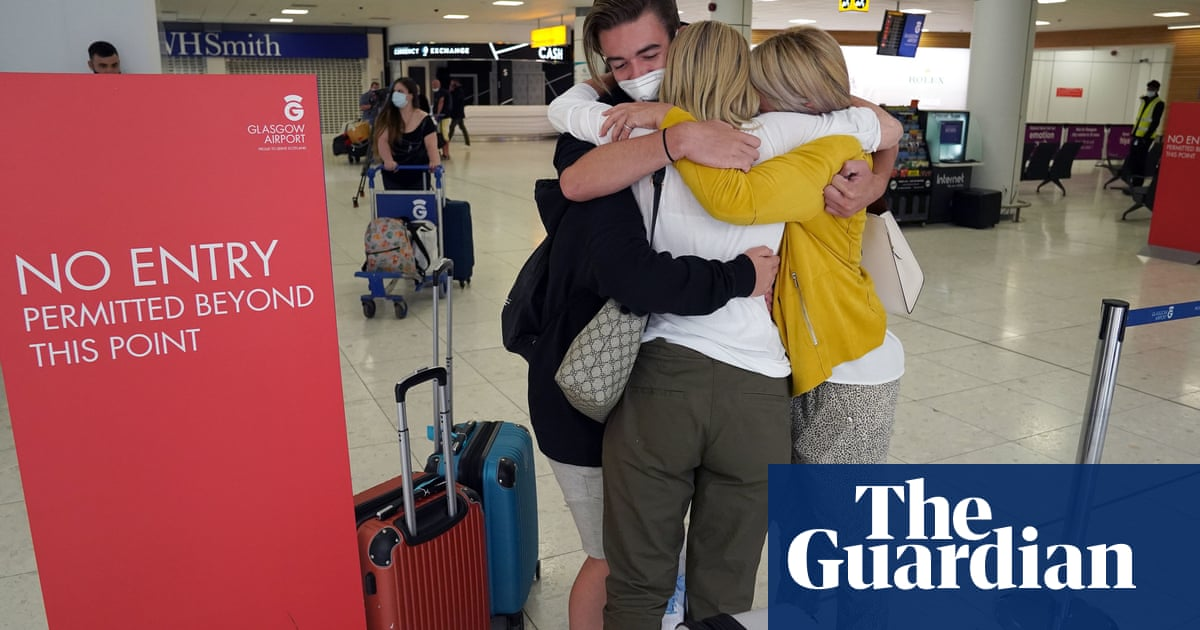 Tearful reunions at UK airports as Covid quarantine rules ease