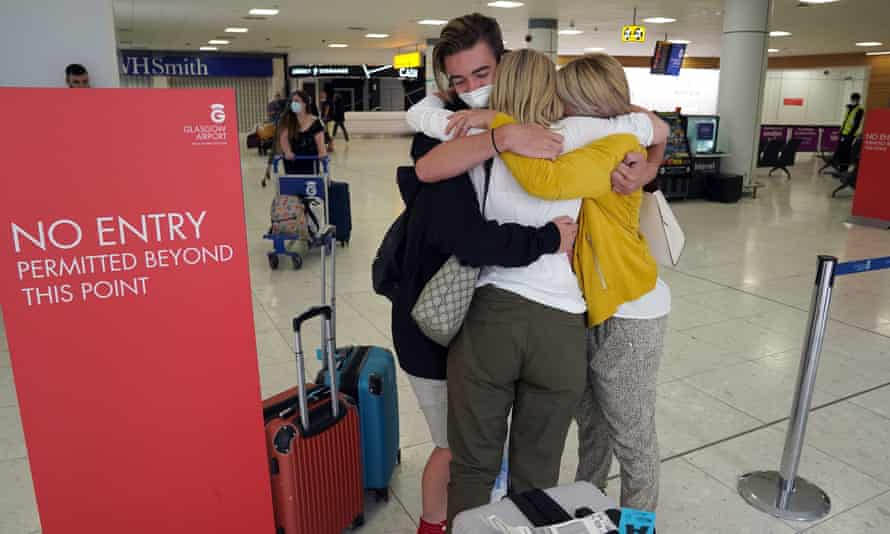 Michelle Bolger (right) with her two sons after arriving at Glasgow airport hugs her sister (back to camera).