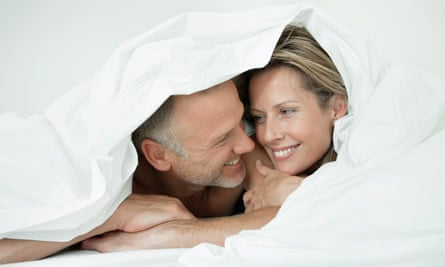 Couple wrapped in a duvetGettyImages-92793122