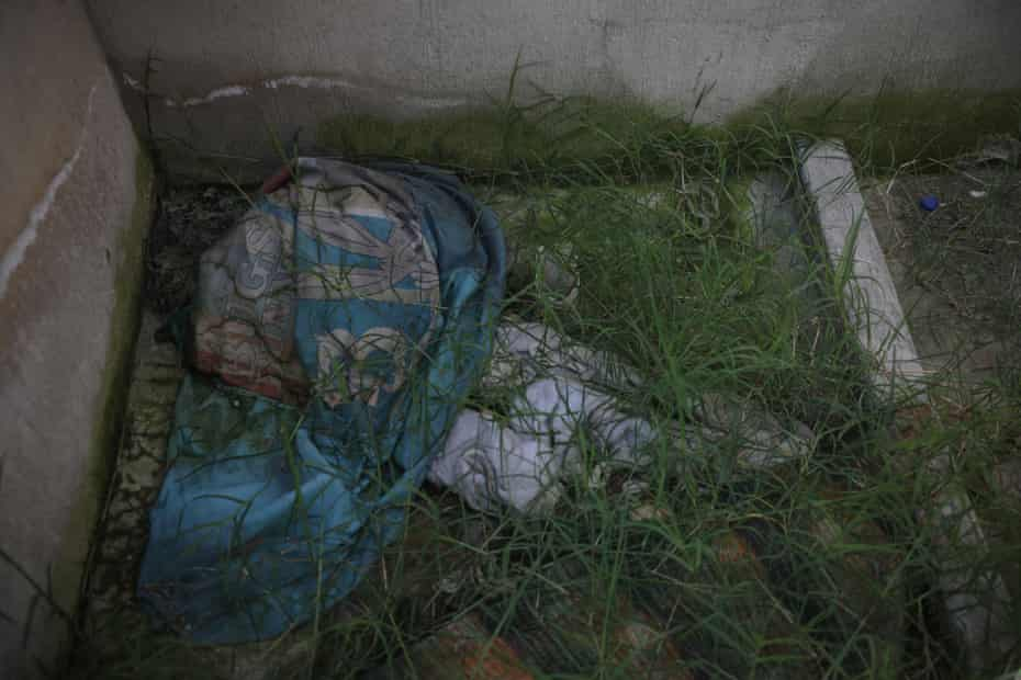 Clothes on the floor where 26 bodies were found inside a clandestine burial place.