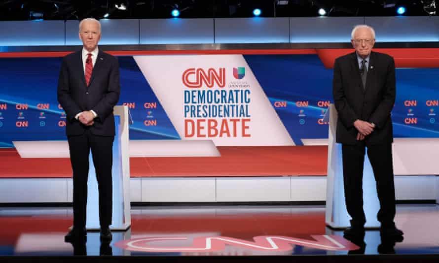 Former Vice President Joe Biden and Vermont Sen. Bernie Sanders participate in the Democratic Presidential Debate.