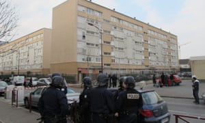Police at the scene of a shooting in Bondy, north-east Paris, where French striker Kylian Mbappe grew up.