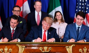 Mexico's president Enrique Pena Nieto, left, Donald Trump and Canadian prime minister Justin Trudeau, sign a new free trade agreement in Buenos Aires, on 30 November.