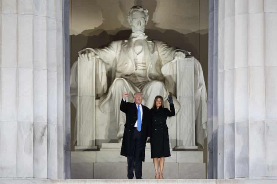 Donald Trump, left, and his wife Melania Trump arrive at the Lincoln Memorial in January 2017.