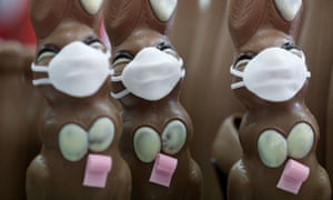Chocolate Easter Bunnies with a protective mask and a roll of toilet paper are seen at a chocolate factory in Pirmasens, Germany, 9 April 2020.