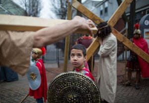 A young boy portraying a Roman soldier takes part in a staging of the Stations of the Cross in the streets of the Boston, Massachusetts, US.