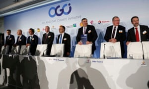 Oil and gas industry leaders arrive to attend a news conference during the Oil and Gas Climate Initiative summit in Paris