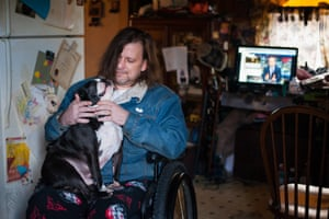 Sgt Ron Frye sits for a portrait with his dog at his home in Buckhannon. Frye is a veteran of several wars who now lives in a wheelchair after being hit by a roadside bomb in Iraq.