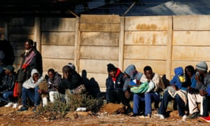 Zimbabweans queue outside a home affairs department office to apply for passports in Harare