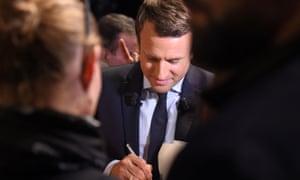 Macron signing autographs