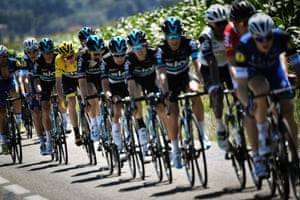 Christopher Froome rides behind his teammates.