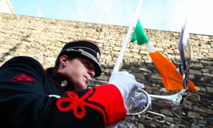 Bandswoman Jane Hilliard from the Irish army No 1 band plays The Last Post as a wreath was laid at Kilmanham jail, where the 1916 leaders were executed.