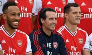 Arsenal's Unai Emery sat alongside Pierre-Emerick Aubameyang and new captain Granit Xhaka.