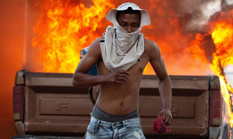 A person runs during clashes between opponents of Venezuelan president Nicolas Maduro and troops in Pacaraima, on the border with Brazil.