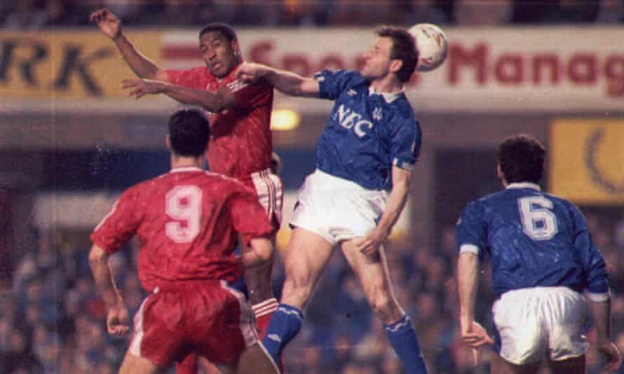 John Barnes and Dave Watson contest an aerial duel in the historic 4-4 FA Cup draw in 1991