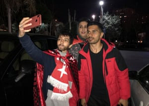 Zeinab takes a selfie with a Perspolis football player in a hotel in Tehran. She had gone to the stadium disguised as a man.