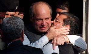 Nawaz Sharif embraces party colleague Sufdar Hussian Shah outside the supreme court in Karachi.