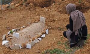 Aisha visits the infant's grave.
