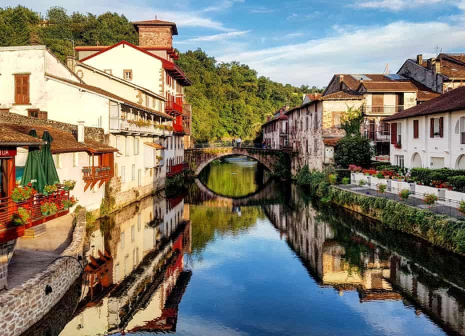 Arch Bridge Over Canal Amidst Buildings Against SkyPhoto Taken In Saint-Jean-Pied-de-Port, France