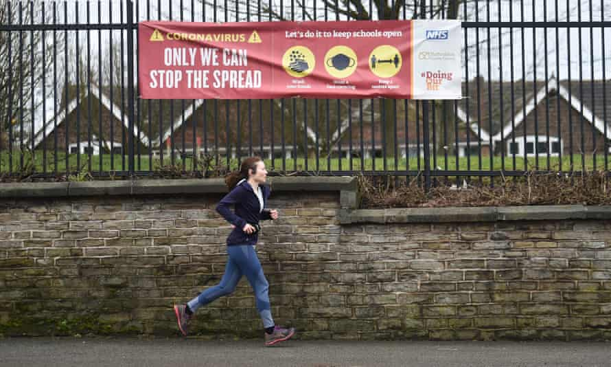 A woman runs past St Saviour's academy primary school in Talke, Staffordshire.