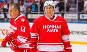 Vladimir Putin takes to the ice alongside Russia's acting defence minister Sergei Shoigu