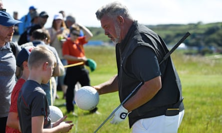 Darren Clarke signs autographs during a practice round prior to the Open Championship at Royal Portrush.