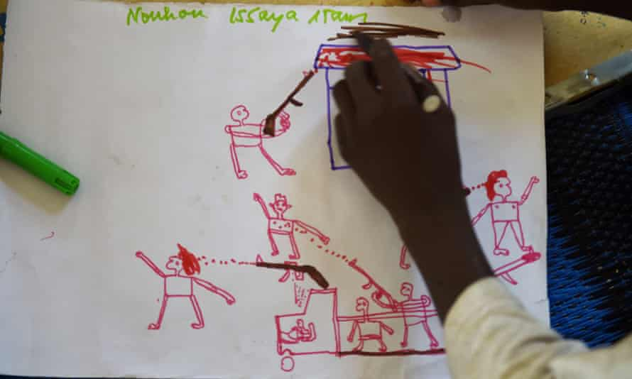 A child draws images depicting Boko Haram attacks, from a refugee camp in Chad.