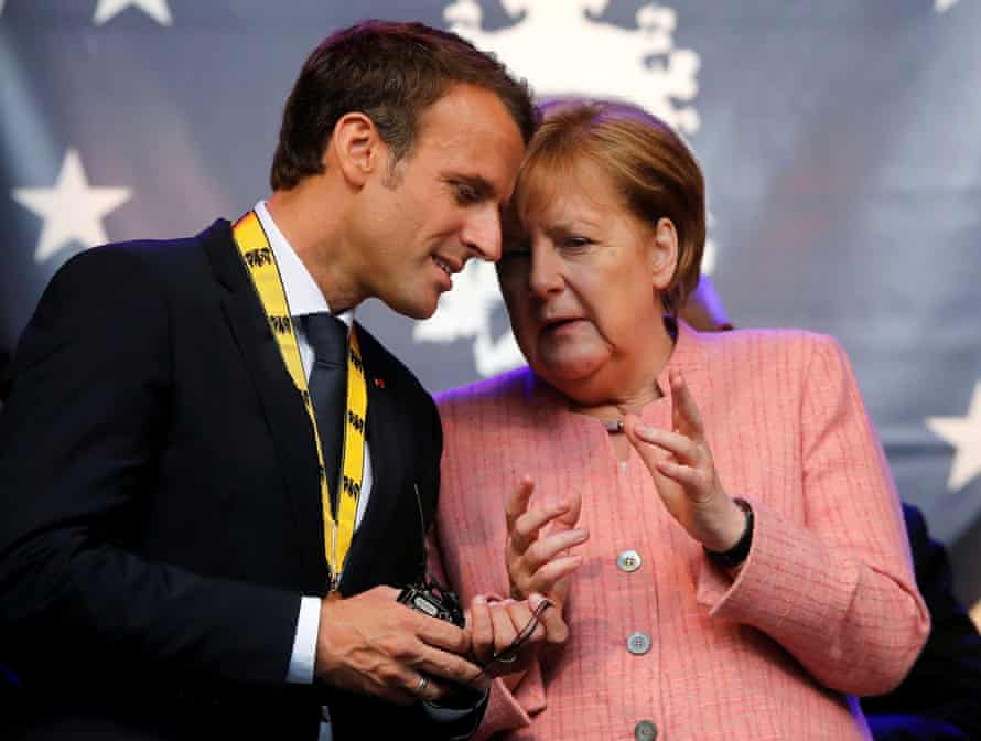 Macron and Merkel in Aachen, where the French president was awarded the Charlemagne prize