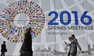 A banner announces the 2016 spring meetings of the IMF and World Bank