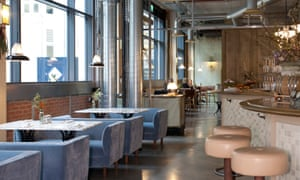 The dining room at Lino, with a gleaming concrete floor, acquaduct