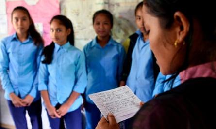Asha Charti Karki (R), who got married at 16, mentors young girls in Surkhet district, Nepal.
